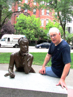 The author with Phillis's statue at the Boston Women's Memorial.