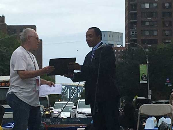 Richard Kigel accepting the Wheatley Book Award for Nonfiction at the Harlem Book Fair, 2018